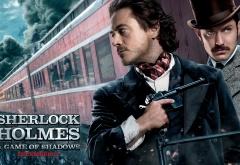 Роберт Дауни мл. и Джуд Лоу на афише фильма Шерлок Холмс: Игра теней