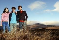 Трио на фоне гор